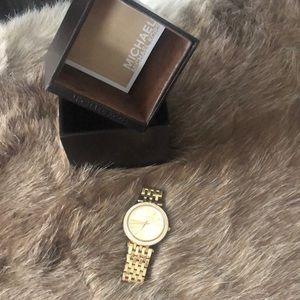 Michael Kors gold diamond watch.